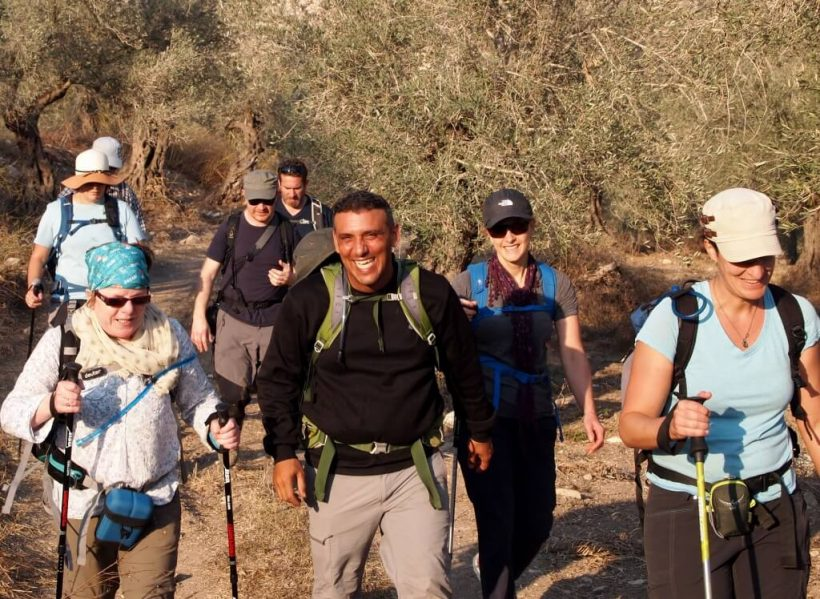 Laughing Palestinian guide during West Bank Hike by Carla Ribeiro