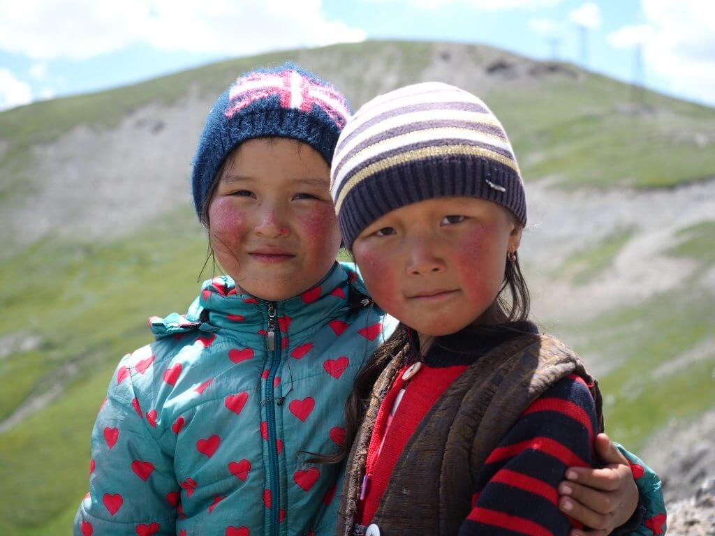 asian children posing for picture on the silk road