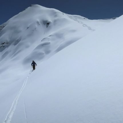lone skier on snowy silk road mountains