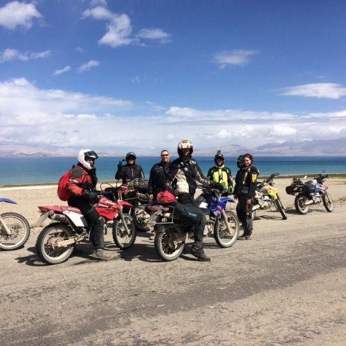 Group Motorcycle Tour Tajikistan in front of a lake